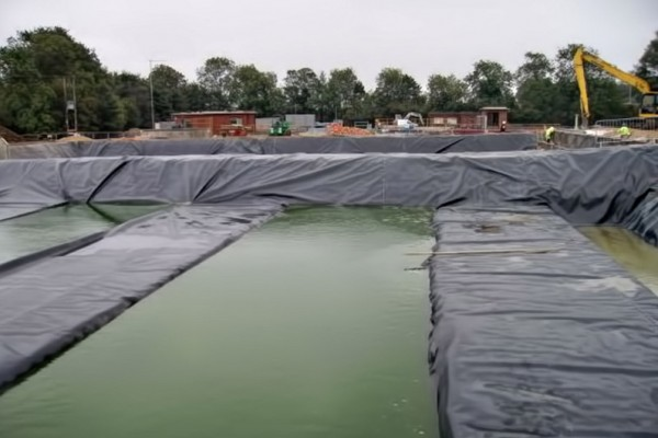 Attenuation wrapping membrane for shoe box installations