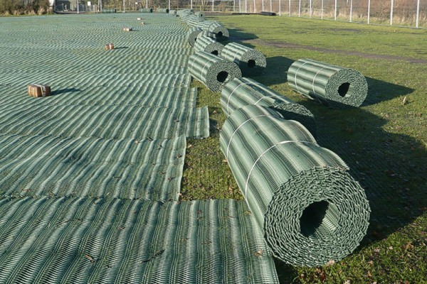 Grass protection rolls being laid out on site