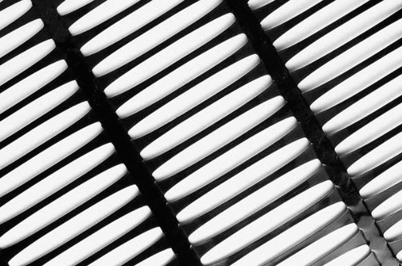 Unixial geogrid photographed on a white background
