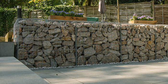 gabion baskets filled with stone in a garden