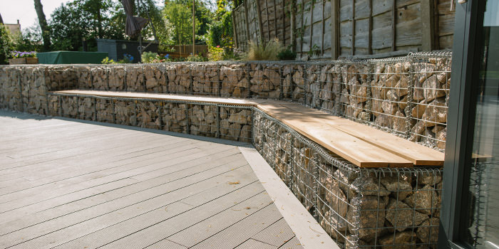 gabion baskets being using for seating in a landscaped garden