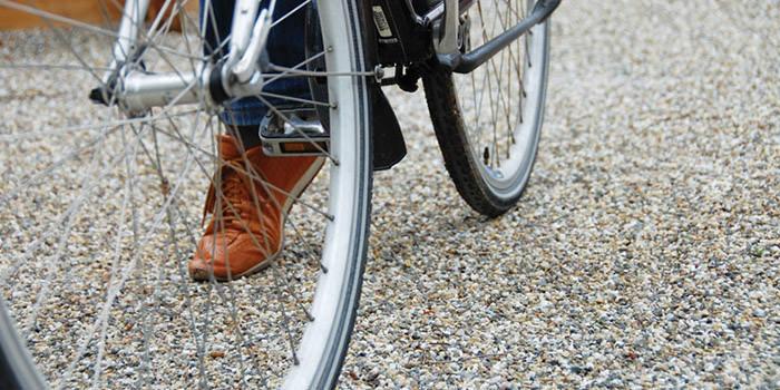 bike riding over landscaped gravel path