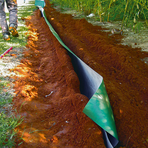 plantex root barrier being installed into the ground to stop bamboo shoots