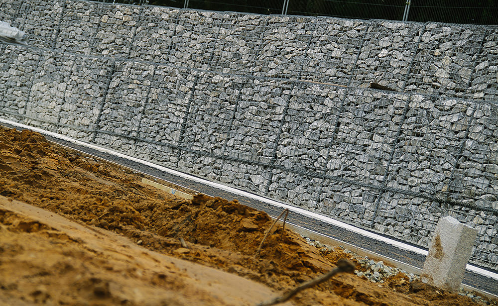stacks of gabion baskets used for a retaining wall